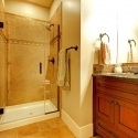 Bathroom with wood cabinet and tile shower.